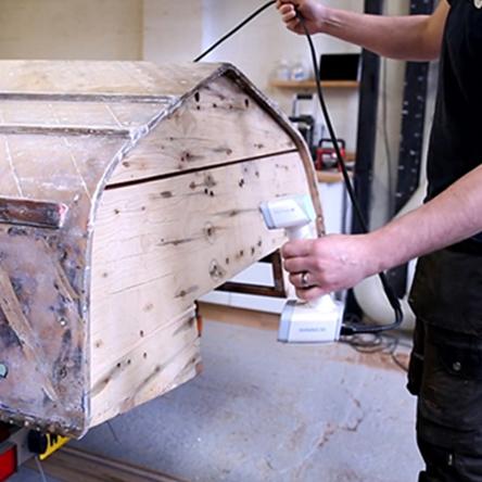 EinScan H scanning a wooden boat